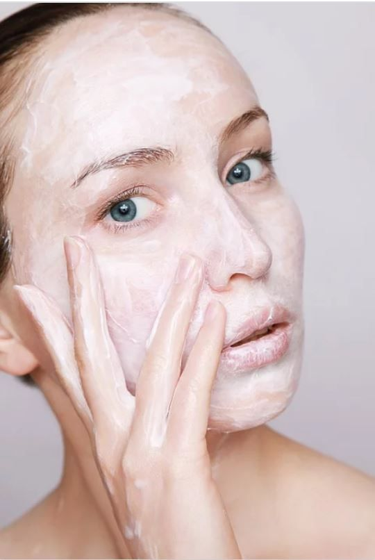 Face Covered With Skincare Product