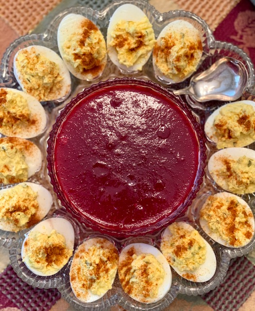 Deviled eggs and cranberry jelly