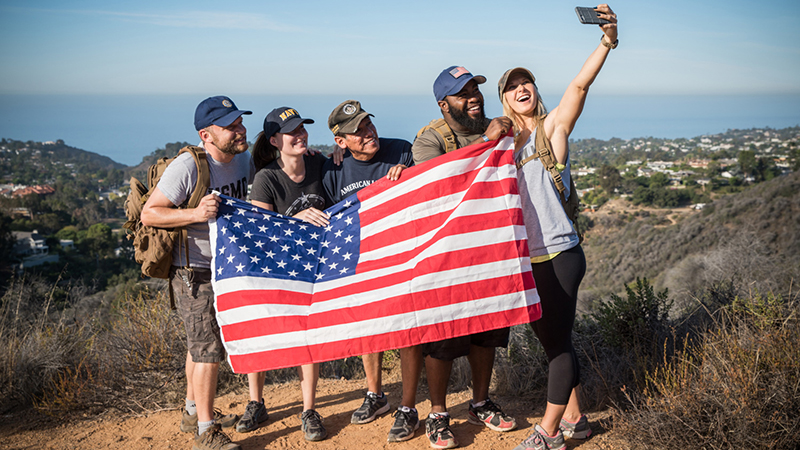 Young people hoding american flag